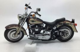 Franklin Mint: A boxed Harley Davidson 1998 Fat Boy by Franklin Mint. Boxed with papers and Hemet.
