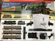 Hornby: A boxed Hornby Flying Scotsman set R 1072. Complete and unused. Some box damage to end