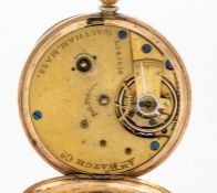 A yellow metal Waltham ladies open faced pocket watch, gold tone dial, with painted black Roman