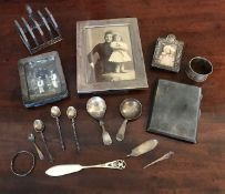 A parcel of assorted silver, to include three easel photograph frames of varying sizes, a five bar