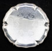A Victorian silver salver, beaded rim, engraved centre on three ball and claw feet, by Goldsmith's