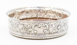 A George III silver wine coaster, the sides later chased with flowers, turned wooden base, marked on