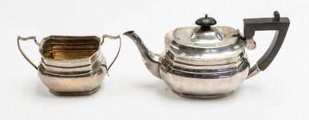 Asprey & Co: A George V part silver tea service to include teapot and sugar bowl, plain bodies,