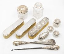 A collection of dressing table items to include silver toppedtable jars, silver handled shoe