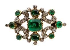 A Victorian diamond and emerald set brooch, comprising a cushion cut emerald set to the centre, size