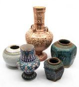 A group of earthenware to include: an Iznik style blue and white pottern vase; a large lustre vase