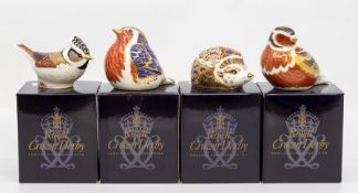 Four Royal Crown Derby paperweights, gold stopper, in box, to include a hedgehog, crested tit, robin
