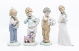 Four Nao figures of young children including two boys and two girls