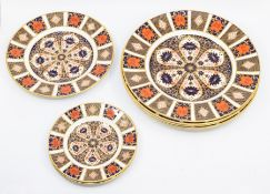 Four Royal Crown Derby 1128 pattern large plates, first quality with matching medium and two small