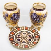 A pair of Carlton Ware ovoid vases, blue flowers with gilding, raised on four feet; and a Royal