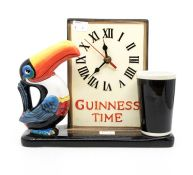 A late 20th Century Guinness Toucan clock, battery operated