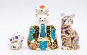 Three Royal Crown Derby paperweights, no stoppers, Royal cat, sitting cat and a gerbil