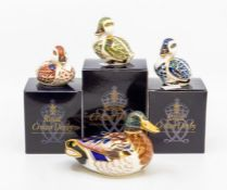 Four Royal Crown Derby paperweights of ducks, three with boxes, all gold stoppers