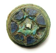 Anglo-Scandinavian Cloisonne Brooch.  Circa 10th century AD. Size: 22.91 mm. A copper-alloy disc