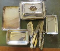 A large group of plated wares to include knives, serving dishes, nut crackers, etc.