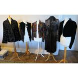 """A black velvet long waistcoat with pearl buttons down the front small 16"""" by Slimma and a black"""