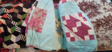 A late 1930s early 1940s turquoise background quilt with squares of assorted colourways of patchwork