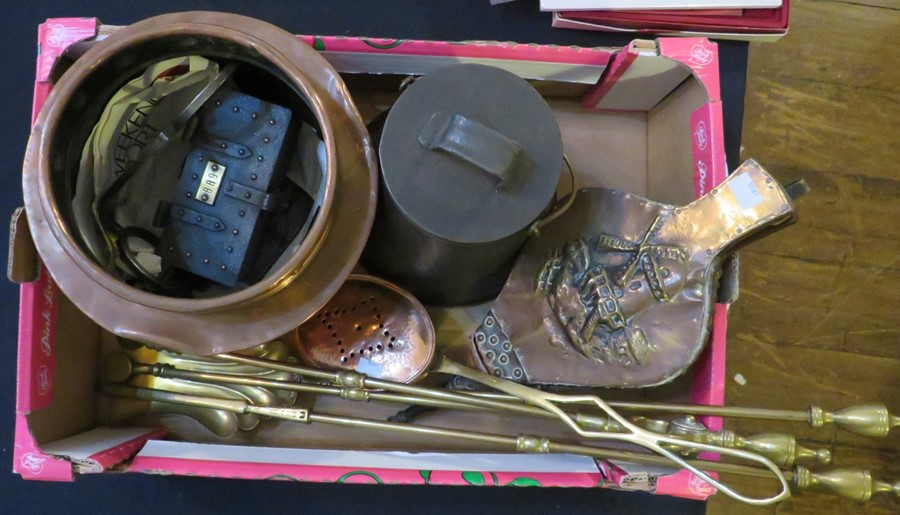 A group of metal ware to include a copper bowl, brass fire irons, bellows, etc