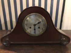 A mid 20th Century mahogany arched bracket clock with Westminster chiming mechanism (pendulum)