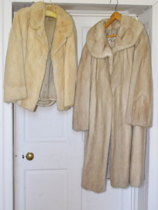 A 3/4 mink jacket with large lapels, 1970/80. A full length mink coat with a large round collar with