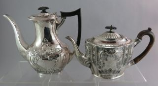 A silver hallmarked teapot and coffeepot, one with ebonised handle. 1480g