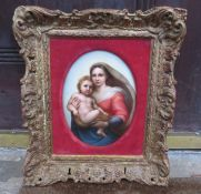 A continental, probably German hand-painted porcelain plaque depicting mother and child in a gilt