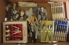 A large quantity of cutlery to include sets of spoons, forks, knifes, some in presentation boxes. (