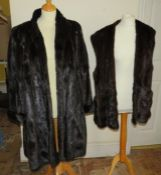 A full length ranch fur coat in black 1960s together with a dark brown gilet 1970s.