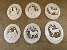 A set of six late 19th Century European carved bone fretwork oval medallions (6) In good overall