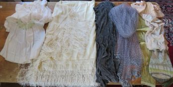 A collection of textiles to include a large cream piano shawl 1920s in fine wool with silk tassels