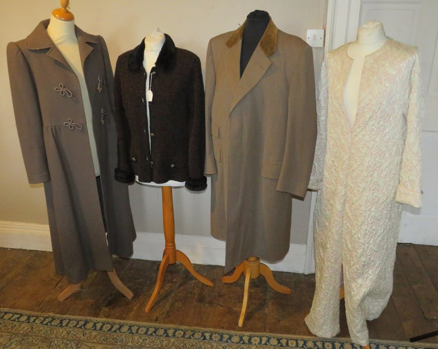 A dark brown and bronze boucle jacket with faux fur collar and cuffs. A man's gabardine over coat in