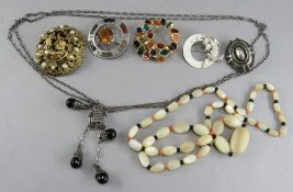 A Scottish hardstone Celtic brooch, two silver brooches etc (7)