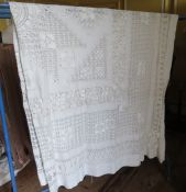 A large white bedspread in drawn thread work c.1910.