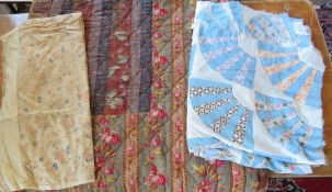 A heavily quilted Edwardian 1920s quilt in autumnal shades, both sides damaged to patchwork, a