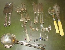 A large group of plated cutlery to include: fish servers, fish knives and forks, cake knife and