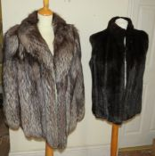 A silver fox 3/4 coat 1980s together with black gilet made by Emba 1980s.
