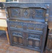 An early twentieth century oak court cupboard with carved details. 109 cm wide.