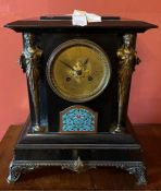 A French ebonised marble, gilt metal and champleve mantel clock, rectangular moulded end top,