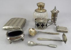 A group of silver items to include cigarette case, vinaigrette, spoons, open salt, a pepper etc. All