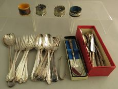 A group of stainless steel and EPNS cutlery and four napkin rings, some boxed. (q)