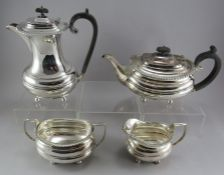 A four-piece plated tea and coffee service with gadrooned edges. Teapot, coffeepot, sugar and