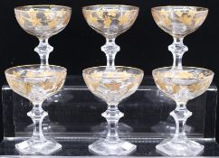 A set of six faceted crystal coupes, with gilt vine decoration, hexagonal bases (6)