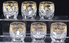 A set of six faceted crystal tumblers, gilt vine decoration (6)