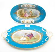 A Sevres twin-handled oval dish; and another dish, Chateau de Tuileries, painted with classical