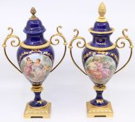 Two continental twin-handled pedestal vases, transfer printed scene, gilt metal mounts, pineapple