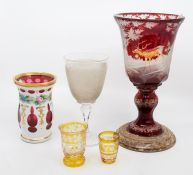 A 19th century Bohemian ruby flash etched chalice, with stags and deer in woodland, on a later
