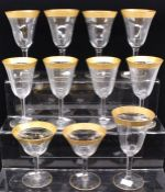 A group of eleven wine glasses, with gilt rims (11)
