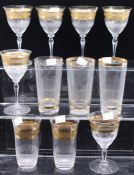 A group of gilt rimmed drinking glasses, wine and beakers (11)