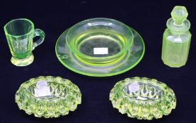 Uranium glass - a pair of ashtrays (ex-Christies labels); scent bottle; cup; dish (5)