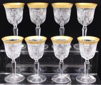Eight cut crystal wine glasses, gilt rims (2 sets of four) (8)